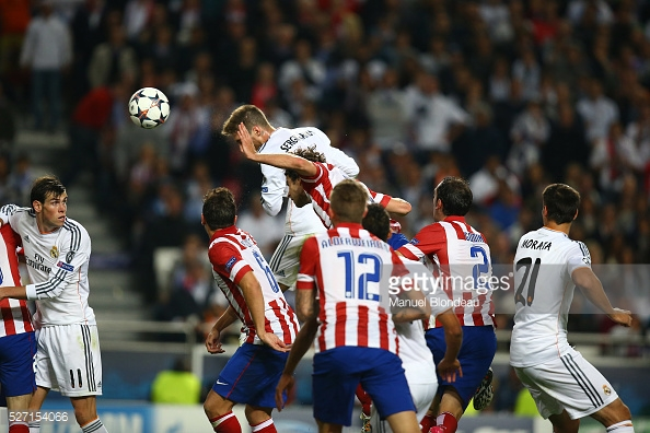Sergio Ramos of Real Madrid heads the ball to score the equalizing goal during the UEFA Champions League Final between Real Madrid CF and Club Athletico de Madrid at Estadio da Luz in Lisbon, Portugal, on May 24, 2014. Photo: Manuel Blondeau/AOP.Press/Corbis